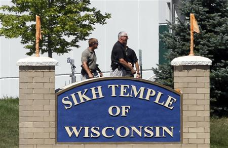 Officials gather near the Sikh Temple in Oak Creek in Wisconsin August 5, 2012 following a mass shooting inside and outside the Sikh Temple. REUTERS/Allen Fredrickson